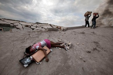 The body of Fabiene Cherisma, 15, who was shot in the head while looting for anything that could be used for survival after the earthquake that struck the capital city of Port au Prince in January 2010. Photo: Paul Hansen
