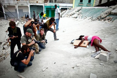 A group of journalists photograph the body of Fabiene Cherisma, 15, who was shot in the head while looting for anything that could be used for survival after the earthquake that struck the captial city of Port au Prince in January 2010.