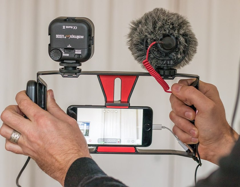 mobile journalism kit with phone, light, microphone and bracket mount