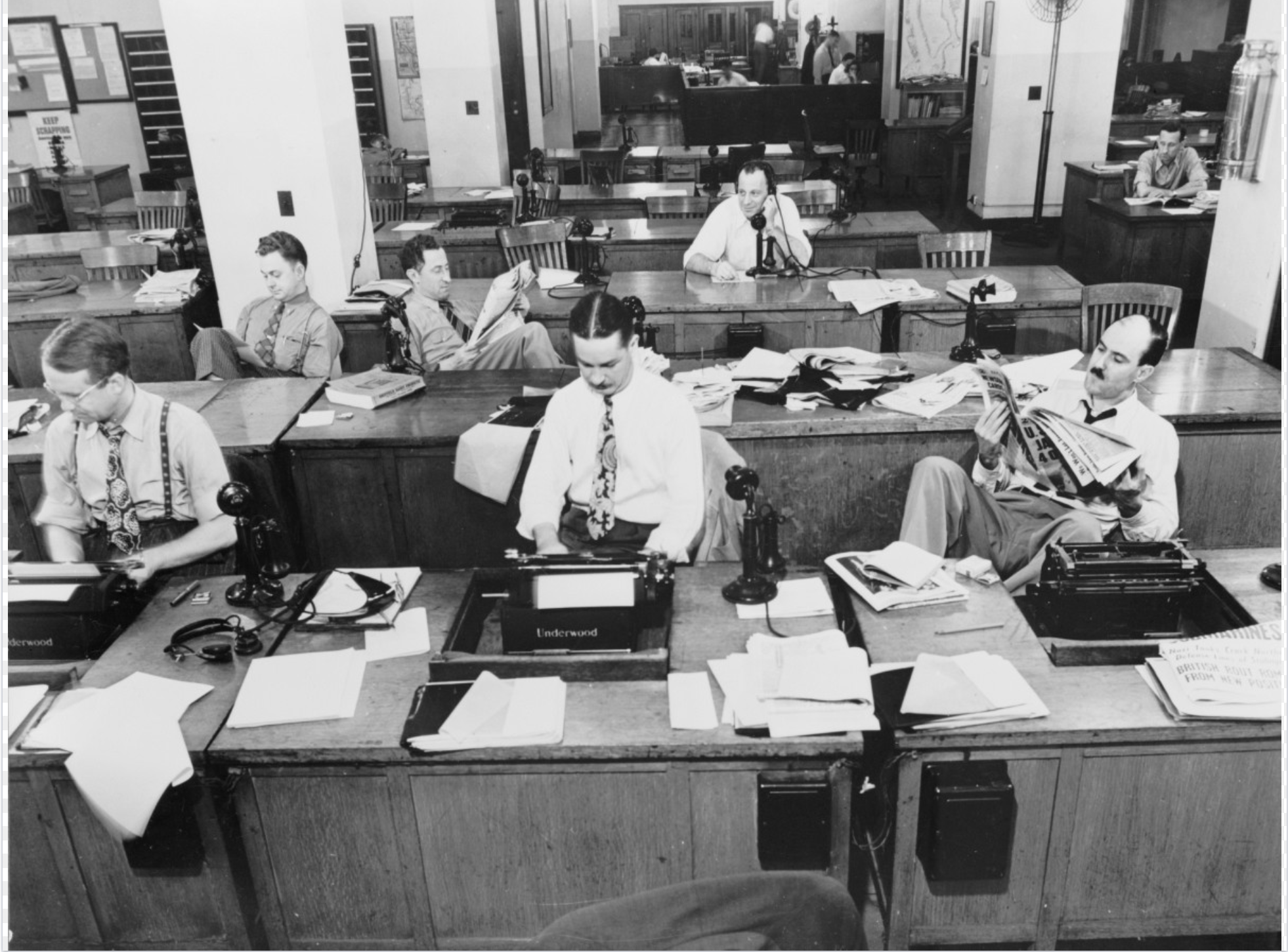 retro shot of journalists in a newspaper office