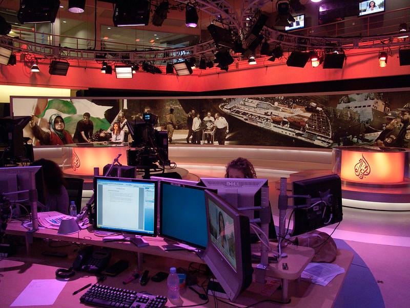 journalists in the al jazeera newsroom