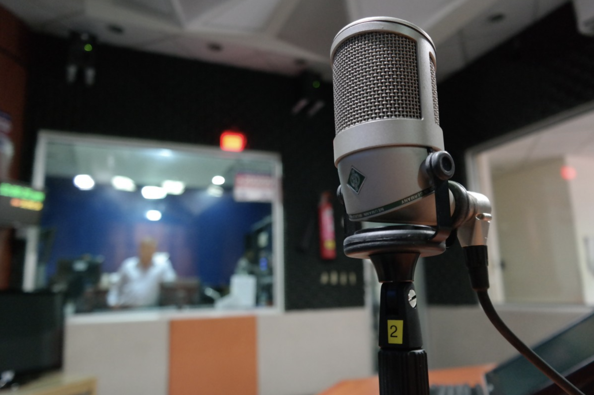 close up of a microphone in a radio studio